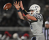 Tommy Heuer #10, Oceanside quarterback, takes a snap during the Nassau County Conference I varsity football final against Freeport at Hofstra University on Saturday, Nov. 18, 2017. Oceanside won by a score of 17-0.