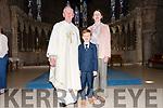Scoil an Ghleanna pupil Ruadh Mac Cartaigh on the day of his First Communion, pictured with his teacher Deirdre Ní Chinnéide and an tAthair Seosamh Ó Beaglaoí at St. Mary's Church, Dingle, on Sunday.