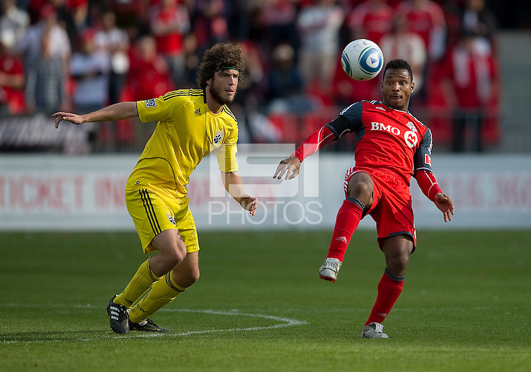 23 April 2011: Columbus Crew forward Tom Heinemann #32 and Toronto FC midfielder Julian de Guzman #6 in action during a game between the Columbus Crew and the Toronto FC at BMO Field in Toronto, Ontario Canada..The game ended in a 1-1 draw.