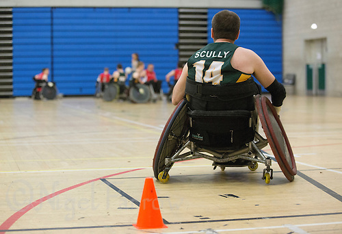 27 MAY 2013 - DONCASTER, GBR - Ger Scully of the Gaelic Warriors guards his teams goal line during their 2013 Great Britain Wheelchair Rugby Nationals match against the Solent Sharks at The Dome in Doncaster, South Yorkshire (PHOTO (C) 2013 NIGEL FARROW)