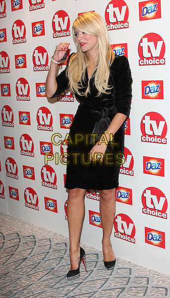 HOLLY WILLOUGHBY .TV Choice Awards 2010 at The Dorchester Hotel, Park Lane, London,  September 6th 2010..full length black dress hand funny shoes platform .CAP/ROS.©Steve Ross/Capital Pictures