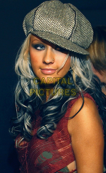 CHRISTINA AGUILERA.Teen People's 5th Anniversary Party held at The Ivar in Hollywood .hat, headshot,portrait, black and blonde hair.www.capitalpictures.com.sales@capitalpictures.com.©Capital Pictures..