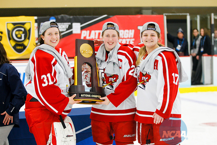 ADRIAN, MI - MARCH 18: Plattsburgh State goalkeeper Camille Leonard (31), defender Erin Brand (28), and defender Julia Duquette (17) accept the championship trophy after winning the Division III Women's Ice Hockey Championship held at Arrington Ice Arena on March 19, 2017 in Adrian, Michigan. Plattsburgh State defeated Adrian 4-3 in overtime to repeat as national champions for the fourth consecutive year. by Tony Ding/NCAA Photos via Getty Images)