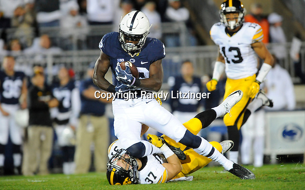 05 November 2016:  Penn State WR Chris Godwin (12) accidentally knees Iowa S Brandon Snyder (37) in the face after making a catch down field. The Penn State Nittany Lions vs. the Iowa Hawkeyes at Beaver Stadium in State College, PA. (Photo by Randy Litzinger/Icon Sportswire)