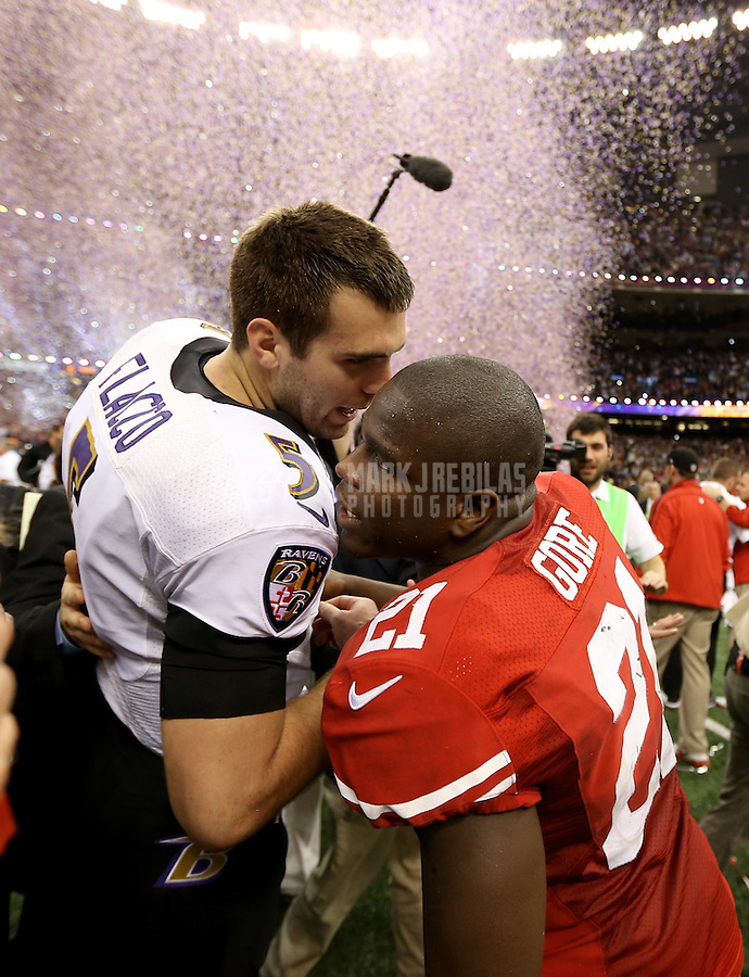 Feb 3, 2013; New Orleans, LA, USA; Baltimore Ravens quarterback Joe Flacco (5) is congratulated by San Francisco 49ers running back Frank Gore after winning Super Bowl XLVII at the Mercedes-Benz Superdome. Mandatory Credit: Mark J. Rebilas-