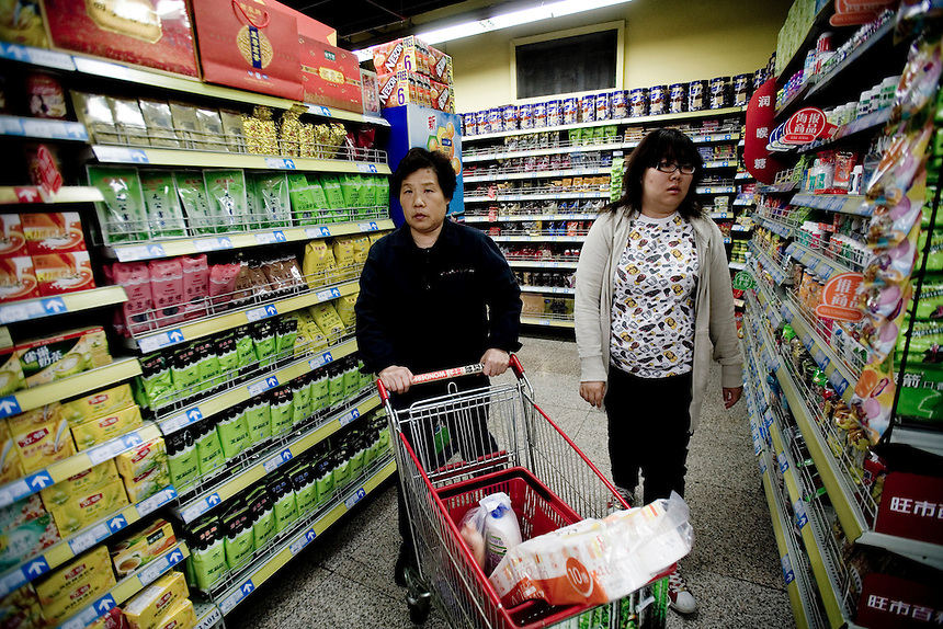 Chinese women shop at a modern supermarket  in central Beijing, China
