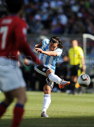 17 06 2010   Johannesburg  Argentina s Carlos Tevez shoots for goal during A 2010 World Cup Group B Match between Argentina and South Korea AT The Soccer City stadium in Soweto Suburban Johannesburg South Africa . The game ended with Argentina winning 4-1.