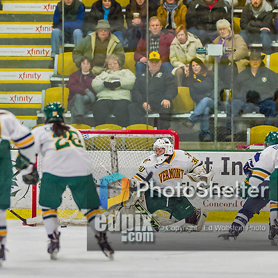 14 February 2015: University of New Hampshire Wildcat Forward Kayla Mork, a Senior from Victoria, MN, scores on Madison Litchfield to open the scoring in the first period against the University of Vermont Catamounts at Gutterson Fieldhouse in Burlington, Vermont. The Ladies played to a 3-3 tie in their final meeting of the NCAA Hockey East season. Mandatory Credit: Ed Wolfstein Photo *** RAW (NEF) Image File Available ***