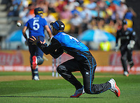 Daniel Vettori catches Stuart Broad during the ICC Cricket World Cup one day pool match between the New Zealand Black Caps and England at Wellington Regional Stadium, Wellington, New Zealand on Friday, 20 February 2015. Photo: Dave Lintott / lintottphoto.co.nz