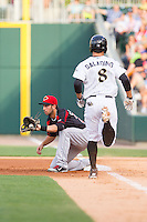 Rochester Red Wings first baseman Chris Colabello (24) fields a throw as Tyler Saladino (8) hustles down the line at BB&T Ballpark on June 5, 2014 in Charlotte, North Carolina.  The Knights defeated the Red Wings 7-6.  (Brian Westerholt/Four Seam Images)