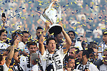 07 December 2014: Los Angeles's Omar Gonzalez lifts the Philip F. Anschutz trophy overhead. The Los Angeles Galaxy played the New England Revolution in Carson, California in MLS Cup 2014. Los Angeles won 2-1 in overtime.