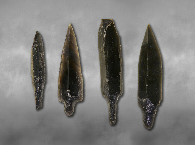 Black obsidian arrow heads. Catalhoyuk Collections. Museum of Anatolian Civilisations, Ankara. Against a gray mottled background