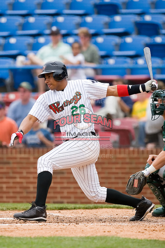 Anderson Gomez (26) of the Winston-Salem Warthogs follows through on his swing versus the Lynchburg Hillcats at Ernie Shore Field in Winston-Salem, NC, Wednesday May 14, 2008.