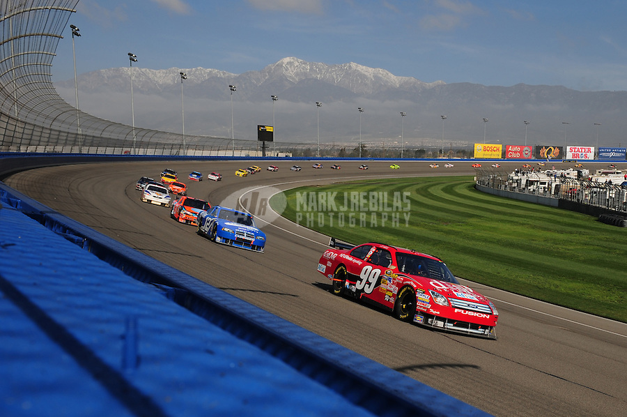Feb 25, 2008; Fontana, CA, USA; NASCAR Sprint Cup Series driver Carl Edwards (99) during the Auto Club 500 at Auto Club Speedway. The race is being run on Monday after wet track conditions forced postponement on Sunday. Mandatory Credit: Mark J. Rebilas-US PRESSWIRE