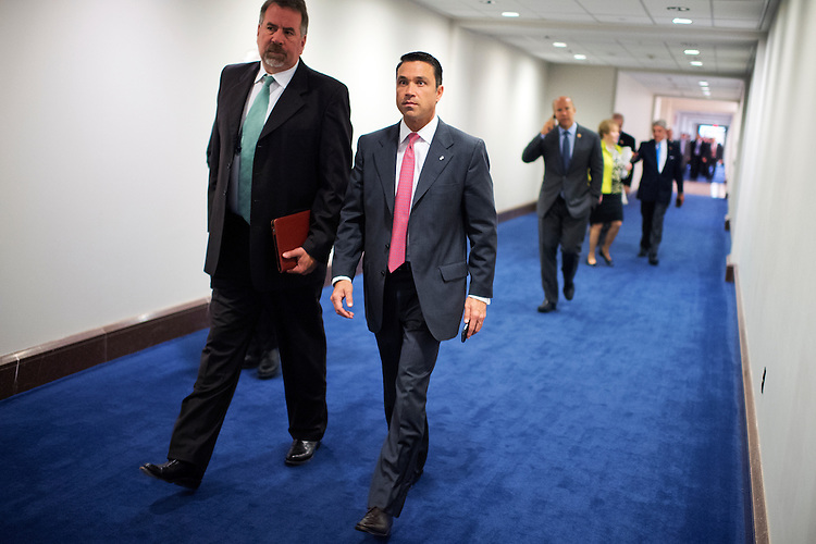 UNITED STATES - SEPTEMBER 11: Reps. Michael Grimm, R-N.Y., right, and Doug LaMalfa, R-Calif., make their way to a closed briefing in the Capitol Visitor Center for House members on the administration's strategy for combating ISIL, September 11, 2014. (Photo By Tom Williams/CQ Roll Call)
