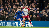 Eden Hazard of Chelsea turns Gareth Barry of WBA during the Premier League match between Chelsea and West Bromwich Albion at Stamford Bridge, London, England on 12 February 2018. Photo by Andy Rowland.