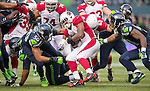 Arizona Cardinals running back Stephan Taylor (30) can't find any running room against Seattle Seahawks strong safety Kam Chancellor   (31) and linebacker Bruce Irvin (51) at CenturyLink Field in Seattle, Washington on November 23, 2014. The Seahawks beat the Cardinals 19-3.   ©2014. Jim Bryant Photo. All Rights Reserved.