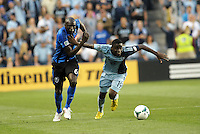 Peterson Joseph (19) midfield Sporting KC holds off Hassoun Camara (6) midfield Montreal Impact .<br /> Montreal Impact defeated Sporting Kansas City 2-1 at Sporting Park, Kansas City, Kansas.