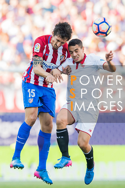 Stefan Savic of Atletico de Madrid battles for the ball with Wissam Ben Yedder of Sevilla FC during their La Liga match between Atletico de Madrid and Sevilla FC at the Estadio Vicente Calderon on 19 March 2017 in Madrid, Spain. Photo by Diego Gonzalez Souto / Power Sport Images
