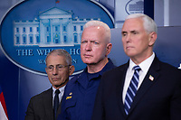 Director of the National Institute of Allergy and Infectious Diseases at the National Institutes of Health Dr. Anthony Fauci; Admiral Brett Giroir, United States Assistant Secretary for Health; and US Vice President Mike Pence listen as US President Donald J. Trump makes remarks on the Coronavirus crisis in the Brady Press Briefing Room of the White House in Washington, DC on Saturday, March 21, 2020.<br /> Credit: Stefani Reynolds / Pool via CNP/AdMedia