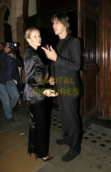 AMANDA HOLDEN & BOYFRIEND.Woman In White Press Night, Palace Theatre, Shaftesbury Avenue, London.September 15th, 2004.full length, black silk, satin jacket, suit.www.capitalpictures.com.sales@capitalpictures.com.© Capital Pictures.