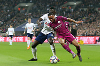 Davinson Sánchez of Tottenham Hotspur and Raheem Sterling of Manchester City during Tottenham Hotspur vs Manchester City, Premier League Football at Wembley Stadium on 14th April 2018