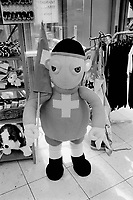 Switzerland. Geneva. Giant doll for sale, wearing the swiss flag and holding in its hand a swiss flag. Souvenirs shop and stuffed animals for sale. © 1999 Didier Ruef
