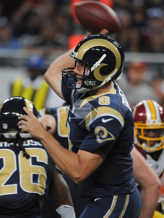 Football - NFL- Washington Redskins at St. Louis Rams.St. Louis Rams quarterback Sam Bradford (8) raises his arm to pass in the third quarter at the Edward Jones Dome in St. Louis.