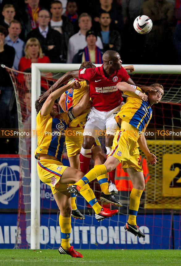 Leon Cort, Charlton Athletic FC meets the cross and heads back across goal - Charlton Athletic vs Crystal Palace - NPower Championship Football at The Valley, London - 14/09/12 - MANDATORY CREDIT: Ray Lawrence/TGSPHOTO - Self billing applies where appropriate - 0845 094 6026 - contact@tgsphoto.co.uk - NO UNPAID USE.