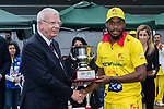 Chris Jordan of City Kaitak (R) is presented with the trophy by Rodney Miles, president of Hong Kong Cricket Association (L) after the final match of the Hong Kong T20 Blitz between Kowloon Cantons and City Kaitak at Tin Kwong Road Recreation Ground, Hong Kong, China. Photo by Chris Wong / Power Sport Images