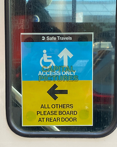 NEW YORK, NY - MARCH 24: A sign at the front of a bus door prompting riders to enter through the back doors due to the coronavirus pandemic in New York City on March 24, 2020. <br /> CAP/MPI/RMP<br /> ©RMP/MPI/Capital Pictures