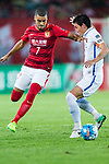 Guangzhou Forward Alan Douglas De Carvalho (L) fights for the ball with Kashima Defender Shoji Gen (R) during the AFC Champions League 2017 Round of 16 match between Guangzhou Evergrande FC (CHN) vs Kashima Antlers (JPN) at the Tianhe Stadium on 23 May 2017 in Guangzhou, China. (Photo by Power Sport Images/Getty Images)