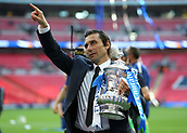 19th May 2018, Wembley Stadium, London, England; FA Cup Final football, Chelsea versus Manchester United; Chelsea Manager Antonio Conte holds the FA Cup while pointing towards the Chelsea fans