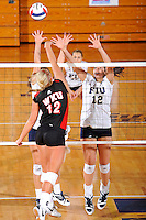 16 October 2010:  FIU middle blocker Sabrina Gonzalez (12) attempts to block a shot in the first set as the Western Kentucky Hilltoppers defeated the FIU Golden Panthers, 3-2 (25-19, 23-25, 25-20, 25-27, 15-13), at the U.S Century Bank Arena in Miami, Florida.