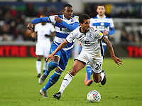 11th February 2020; Liberty Stadium, Swansea, Glamorgan, Wales; English Football League Championship, Swansea City versus Queens Park Rangers; Kyle Naughton of Swansea City is under pressure from Bright Osayi-Samuel of Queens Park Rangers after winning possession