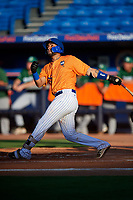 St. Lucie Mets catcher Ali Sanchez (25) follows through on a swing during a game against the Daytona Tortugas on August 3, 2018 at First Data Field in Port St. Lucie, Florida.  Daytona defeated St. Lucie 3-2.  (Mike Janes/Four Seam Images)
