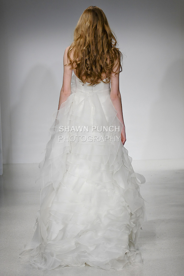 Model walks runway in a Cordelia wedding dress by Amsale Aberra, for the Christos Spring 2012 Bridal runway show.
