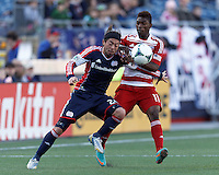 First half action:.New England Revolution midfielder Lee Nguyen (24) attempts to control the ball as FC Dallas defender Fabian Castillo (11) defends..  In a Major League Soccer (MLS) match, the New England Revolution (blue) vs FC Dallas (red), at Gillette Stadium on March 30, 2013.