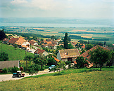 SWITZERLAND, La Coudre, the hillside town with Lake Neuchatel in the distance