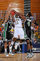 6 February 2010:  FIU's Marvin Roberts (11) attempts to shoot while being fouled by North Texas George Odufuwa (4) in the second half as the North Texas Mean Green defeated the FIU Golden Panthers, 68-66, at the U.S. Century Bank Arena in Miami, Florida.
