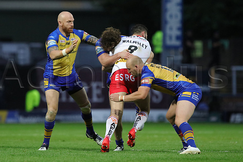 June 29th 2017, Headingley Carnegie, Leeds, England; Betfred Super League; Leeds Rhinos versus St Helens; Alex Walmsley of St Helens is tackled by Carl Ablett of Leeds Rhinos