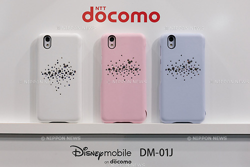 Samples of the DOCOMO smartphone Disney mobile DM-01J on display during the launch event for 8 new mobile devices for the summer lineup on May 24, 2017, Tokyo, Japan. DOCOMO introduced seven new smartphones and one tablet along with a new app and service plans. (Photo by Rodrigo Reyes Marin/AFLO)