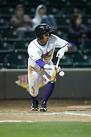 Joel Booker (3) of the Winston-Salem Dash lays down a bunt against the Salem Red Sox at BB&T Ballpark on April 20, 2018 in Winston-Salem, North Carolina.  The Red Sox defeated the Dash 10-3.  (Brian Westerholt/Four Seam Images)