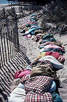 Sand bags and fences help beach from further erosion. Fire Island New York United States North America.