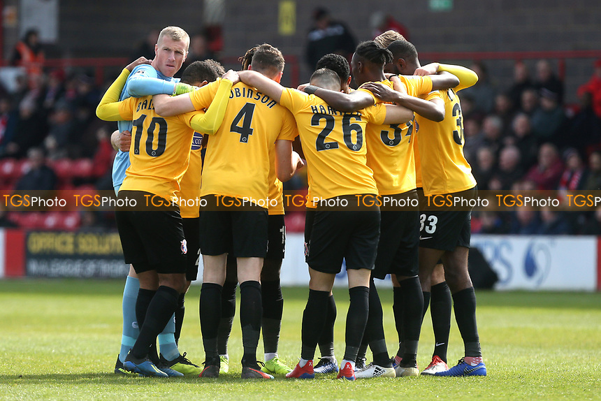 Daggers players huddle during Ebbsfleet United vs Dagenham & Redbridge, Vanarama National League Football at The Kuflink Stadium on 13th April 2019