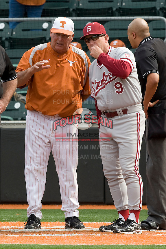 Texas coach Auggie Garrido meets with Stanford coach Mark Marquess before their game on March 4th, 2011 at UFCU Disch-Falk Field in Austin, Texas.  (Photo by Andrew Woolley / Four Seam Images)