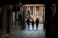 People walk through a passageway in Liverpool, England, UK