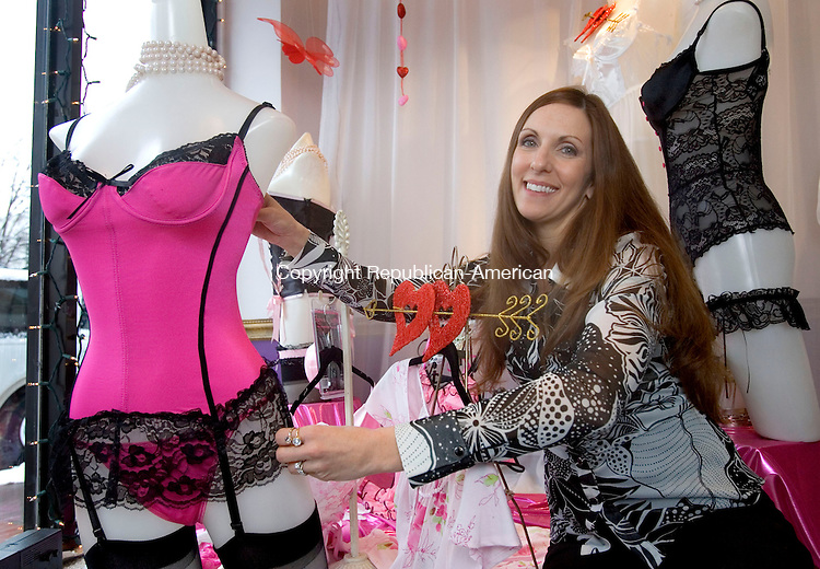 WATERBURY, CT. 26 January 2011-012611SV03--Charlene Jurgaitis, owner, sits by her Valentine theamed window at the Princess Corset &amp; Lingerie Shop on Grand Street in Waterbury Wednesday.<br /> Steven Valenti Republican-American