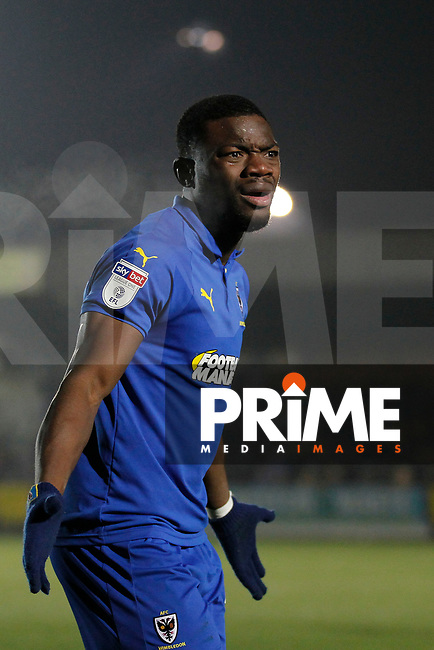 Adedeji Oshilaja of AFC Wimbledon is incredulous during the Sky Bet League 1 match between AFC Wimbledon and Fleetwood Town at the Cherry Red Records Stadium, Kingston, England on 22 January 2019. Photo by Carlton Myrie / PRiME Media Images.