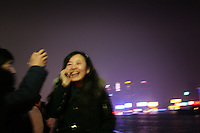 CHINA. Shanghai. A woman on the Bund. Shanghai is a sprawling metropolis or 15 million people situated in south-east China. It is regarded as the country's showcase in development and modernity in modern China. This rapid development and modernization, never seen before on such a scale has however spawned countless environmental and social problems. 2008.